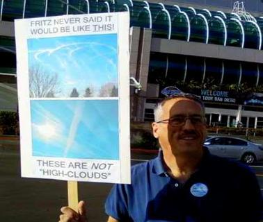 Protest holding 'Chemtrails' sign